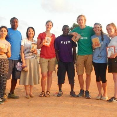 As part of their community work in Ghana, Projects Abroad volunteers on a Team Trip read books with children at their placement.